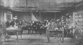 Thomas A. Edison (center, with cap) with workers in his laboratory in Menlo Park, New Jersey. The photo was taken in 1880.
