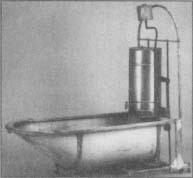 This 1920s bathtub folded up to save space and came with its own hot water heater. (From the collections of Henry Ford Museum & Greenfield Villege.)