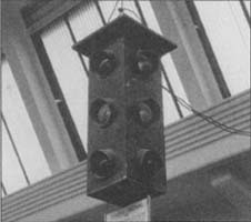 Installed in Detroit in 1920, this was the nation's first three-color, four-way traffic light. (From the collections of Henry Ford Museum & Greenfield Village.)