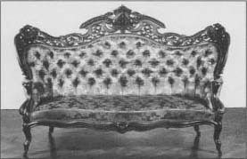 A traditional Victorian sofa purchased as part of a parlor suite by Mary Todd Lincoln after her husband's assassination. (From the collections of Henry Ford Museum & Greenfield Village.)