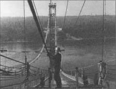 A steel worker lying cable stands for the suspension cable of the new Tacoma, Washington, Narrows Bridge on October 21, 1949.
