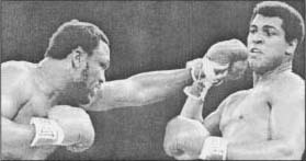 Joe Frazier throwing a punch at Muhammad Ali.